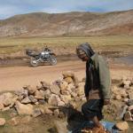 Bolivian Resident Peeling Potatoes